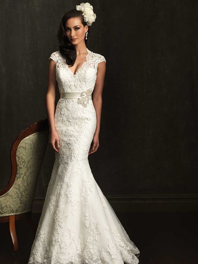 """This is your day and you are ready to wear the charming Allure Bridals 9064 wedding gown for your precious ceremony! The beauty of this gown will bring joy to your heart and you will feel magnificent as you say \""""I do\"""" because the V cut neckline has a contour look as the lace of the bodice comes over the shoulders and creates delicate cap sleeves. With a keyhole back bodice, the soft English Net and lace appliques help the dress express every ounce of the passion you feel. Covered buttons…"""