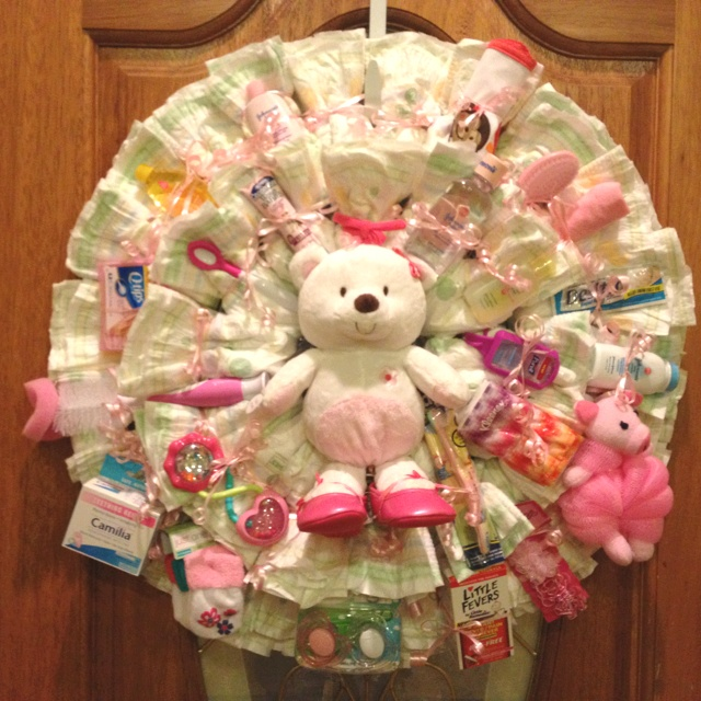 Then Used Curling Ribbon To Wrap Diapers Around Wreath. Tucked In Small Baby  Items. Used It For Baby Shower Memory Game ...