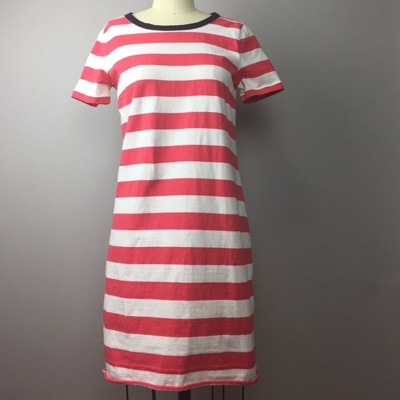 """J.Crew Striped Tee Dress XS Pink and white striped tee dress with navy boat neck collar and rear zip. The hem is unfinished and lends a casual look. 33"""" length, 34"""" pleated bust. 100% cotton. This is a well made piece. There is one small stain on the lower right side of the dress as shown. Only noticeable to me under the photography lighting. Size XS, shown on size 2 mannequin. A56 J. Crew Dresses Mini"""