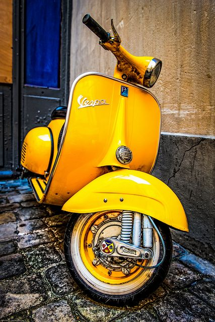 "Seriously...couldn't resist...I had a 1963 in white...I'm a sucker for yellow also...these 1960's Vespa's just remind me of a shapely woman with the rounded ""hips"" of the engine/wheel covers."