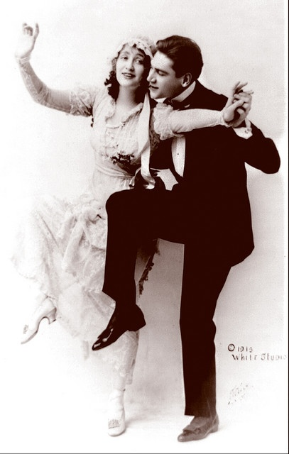 Man in tuxedo and woman in wedding gown dancing, 1913