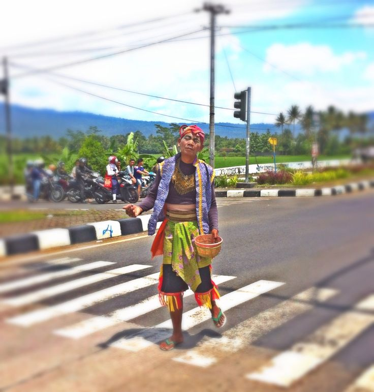 "Javanese traditional arts ""kuda lumping"" entertain people at traffic lights."