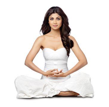 Shilpa Shetty in a white dress doing yoga