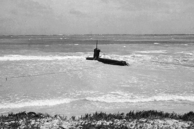 A Japanese midget submarine, part of the attacking force on Pearl Harbor, beached at Bellows Field. (U.S. Navy)