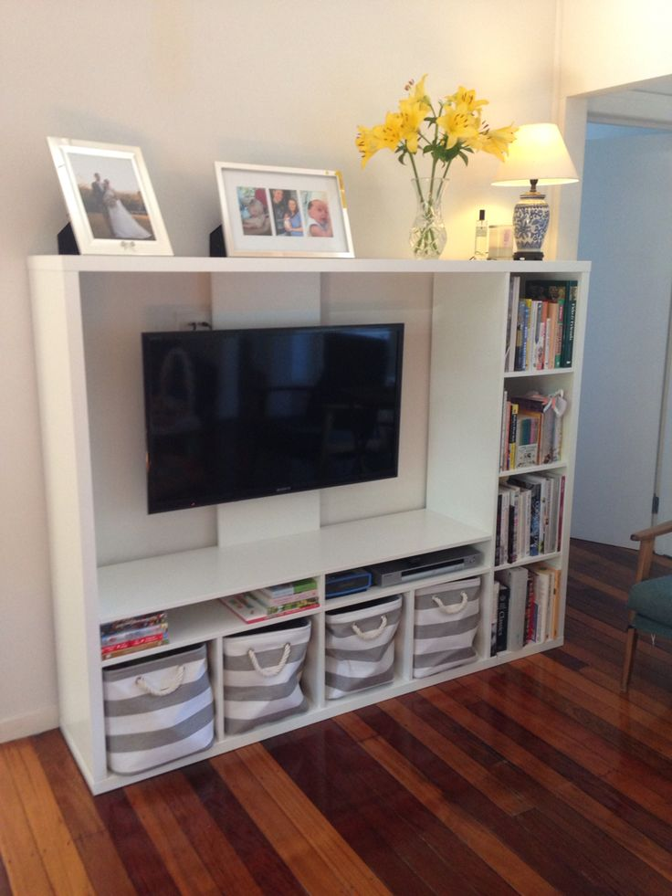 Ikea lapland tv unit with books and storage baskets for Living room storage units