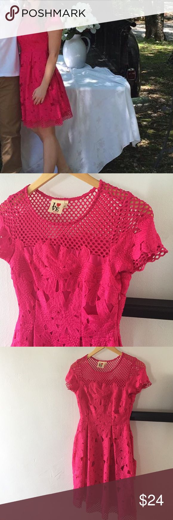 Gorgeous pink dress So beautiful and vibrant! Only worn once to a wedding and it's a shame for this to be just hanging in my closet. Beautiful detail at neckline and hem, side zip. Fuschia pink color and true to size. Dresses