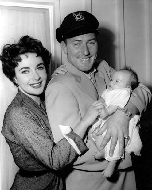 Elizabeth Taylor and Michael Wilding with newborn Junior. January, 1953