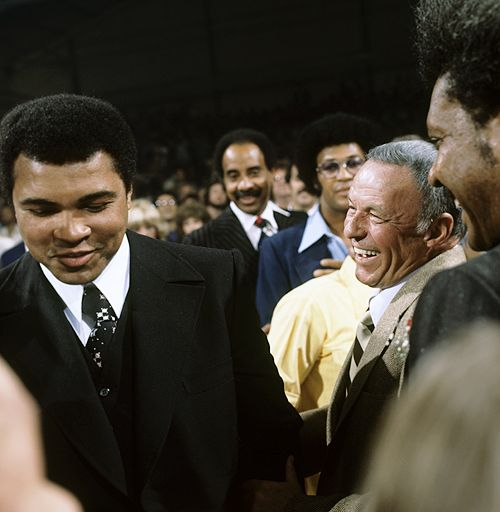 Frank Sinatra and Muhammad Ali in stands before Ken Norton vs. Jimmy Young fight at the Sports Pavilion of Caesars Palace. Las Vegas, NV, November 5th, 1977. Photos by Neil Leifer