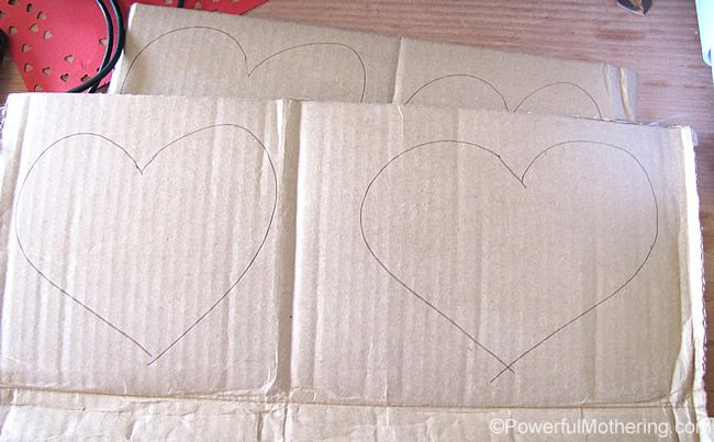 cut out hearts of cardboard