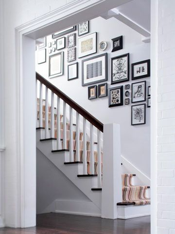 Love the art on the stairs and the simple newel post.  Will repaint my pine posts white like this.  Looks great.