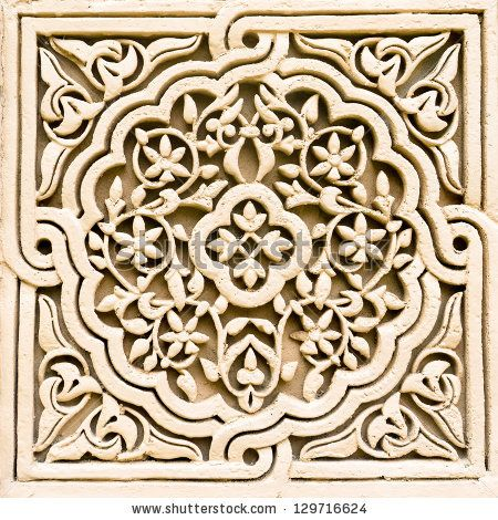 Stone carving of flower motif pattern - stock photo