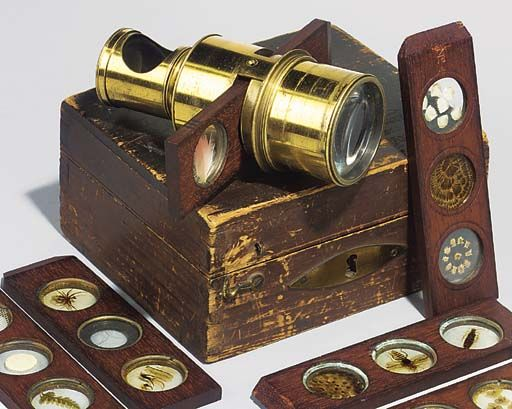 Victorian era microscope with sets of old slides. Just gorgeous.