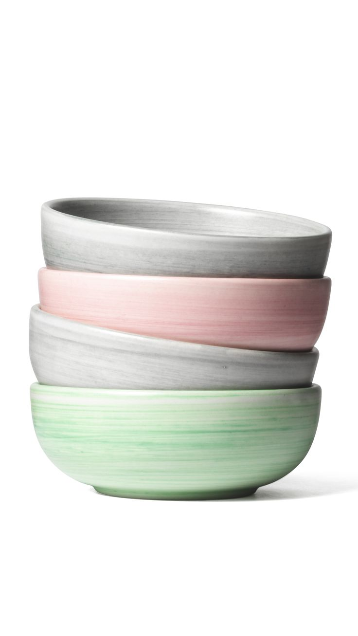 Enrico Zanolla's colourful ceramic bowls are handmade using a paintbrush and a rotating platform, giving them a slightly streaky ring of colour. They are sold in sets of two in pink, green or grey.