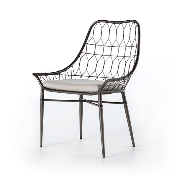 Palmer Arman Outdoor  Dining Chair from The Palmer Collection from Four Hands. The frames are all constructed out of mahogany and mango wood and then entwined with natural banana leaf from Indonesia. The Khazana is a furniture store located