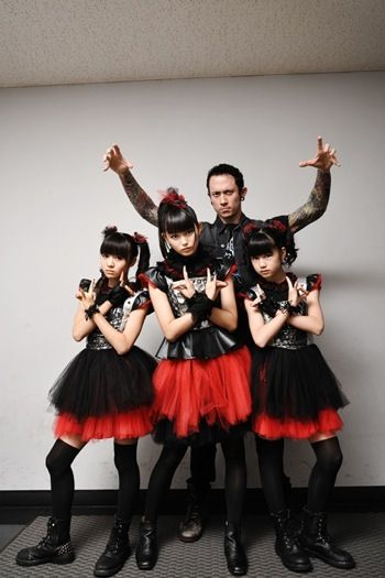 Babymetal with Producer/Svengali (is he doing marionette hands? I hope not)