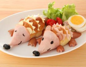 These are super cute and really not that hard. No directions.  Ham for nose, bun sliced w/ham or cheese zigzags, black olives and hot dog feet (personally I would choose something else for the feet)  I think boys would love to help make them.