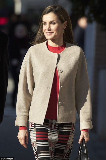 12 January 2017 - Queen Letizia attends a meeting at Feder headquarter in Madrid - skirt and bag by Hugo Boss, shoes by Uterque