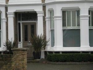 Beige 4 panel glazed Victorian front door