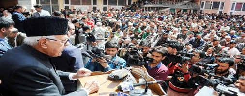 National Conference president Dr. Farooq Abdullah addressing party workers in Srinagar on Tuesday.-Excelsior Photo