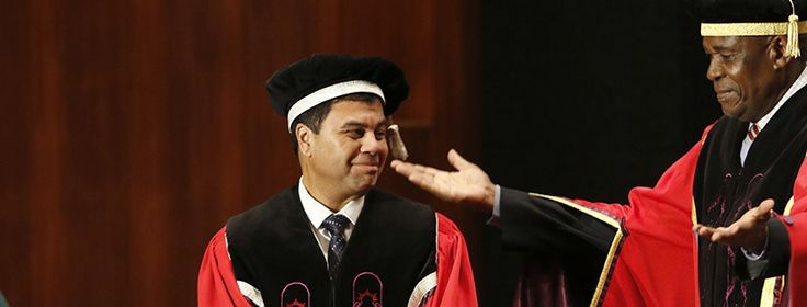 Dr Khotso Mokhele, Chancellor of the University of the Free State (UFS), robes Prof Francis Petersen as 14th Vice-Chancellor and Rector of the UFS.