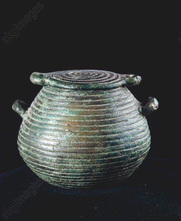 MINIATURE BASKET / SARDINIAN / C9TH BC. Sardinian, 2nd half of 9th century BC. Miniature basket with lid and grove decoration which imitates the decoration of woven baskets. Bronze, cast, height 3.3cm, diameter of the lid 4.5cm. Found at Vulci, necropolis of Cavalupo, Tomb of Nuraghian Small Bronzes, Inv. no. 59919