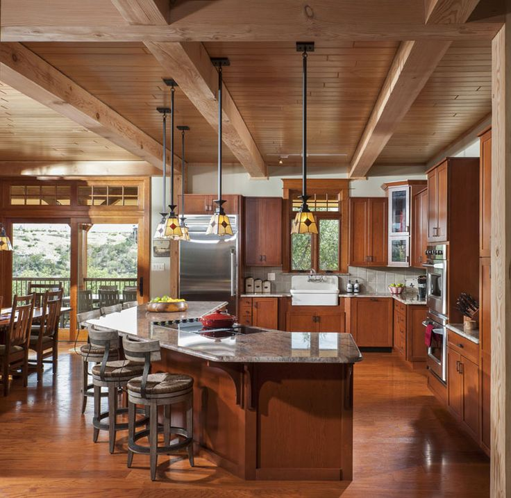 #PossumKingdom Timber Frame Kitchen with granite counter tops and an island breakfast bar.