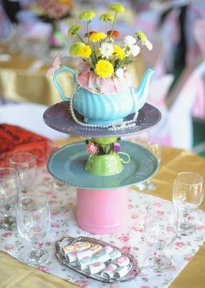 Such a cute centerpeice at a Princess Tea Party with SUCH CUTE Ideas via Kara's Party Ideas KarasPartyIdeas.com #GardenParty #princess #TeaParty #GirlyParty #PartyIdeas #PartySupplies #centerpiece