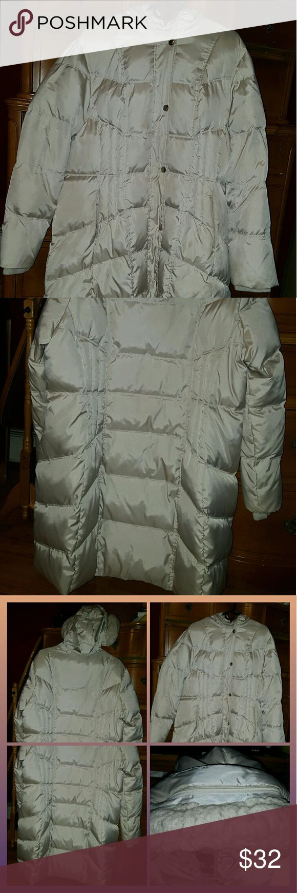 Ladies preowned long winter puffer coat Preowned ladies long winter coat hangs below knees. Good condition no rips, stains or smells. Beige color size xl/ 1x. Very warm and snuggly. Apt. 9 Jackets & Coats Puffers