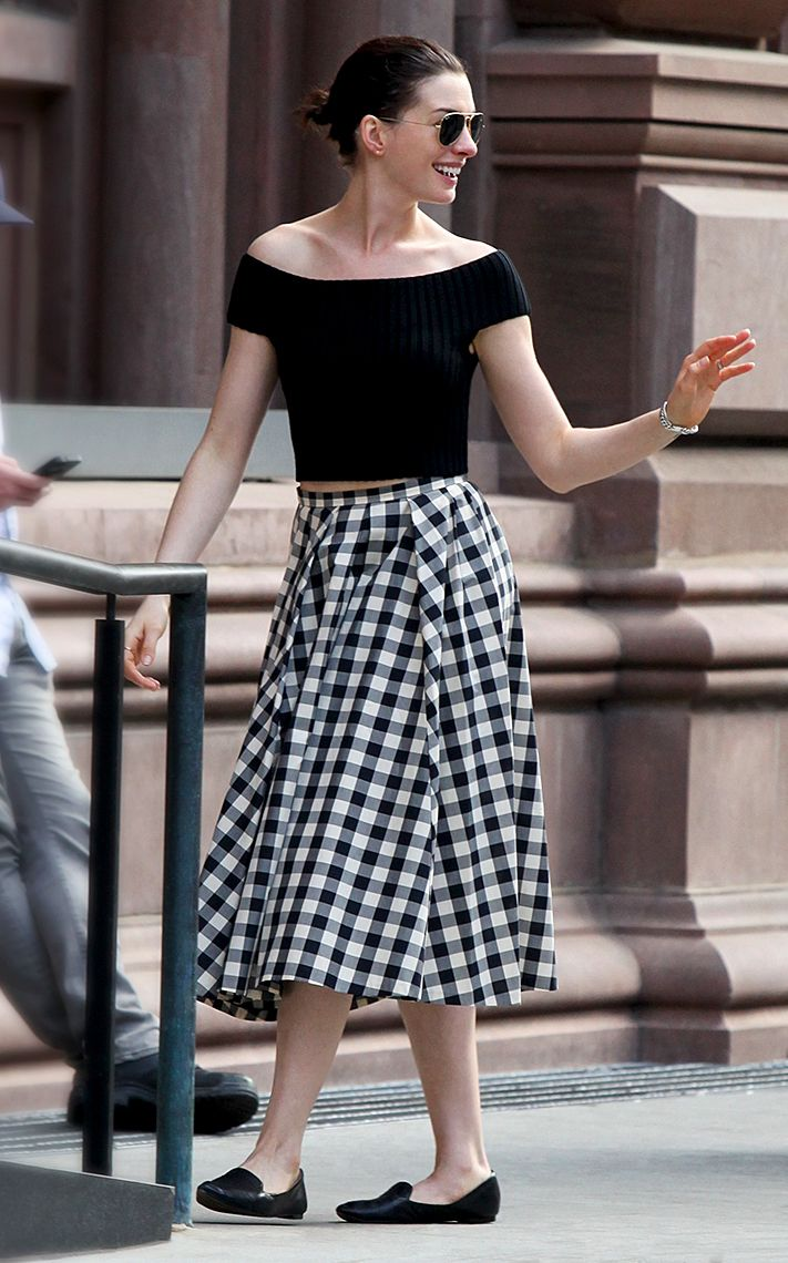 Ann Hathaway wearing Michael Kors Spring 2015 black merino sweater and muslin gingham cotton skirt. May 2015