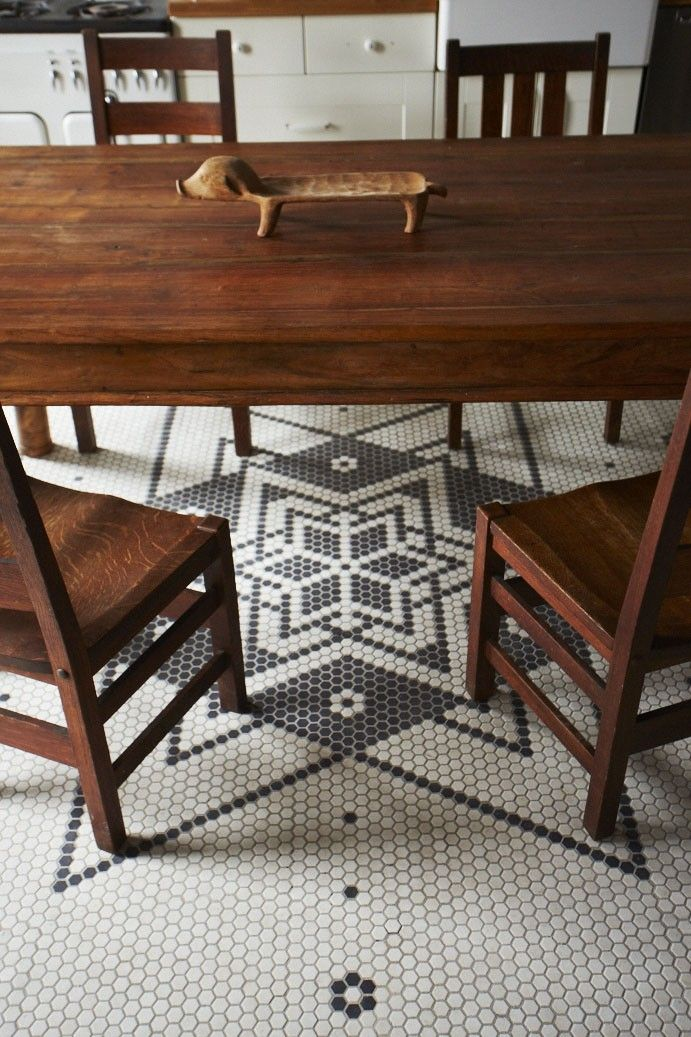 This might be a nice option for our dining room/kitchen flooring. Not a big fan of the black and white pattern, but something along this line with some color might look nice...