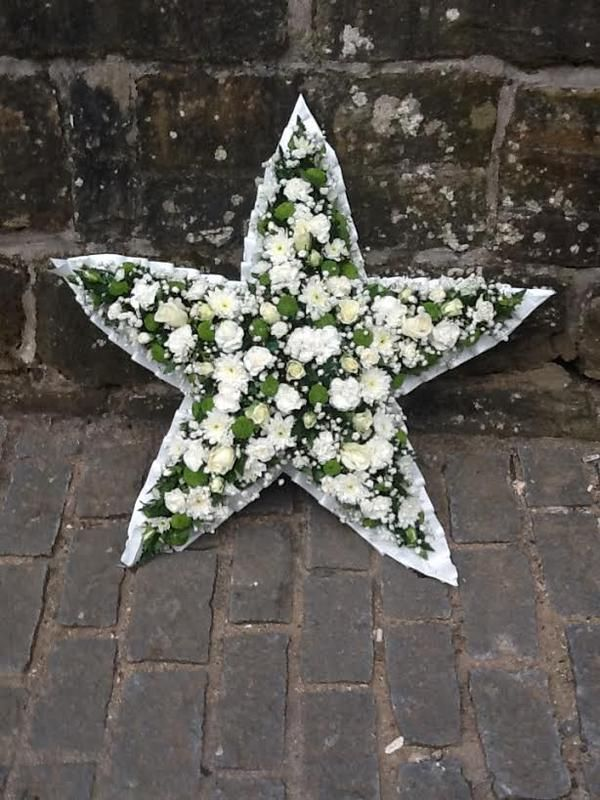 Glittery White Star by Amy and the girls at Flowers By Karen