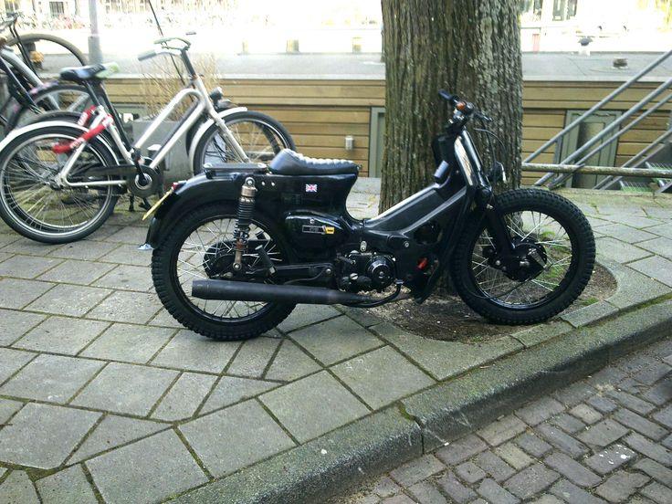Cool blacked out custom Honda cub