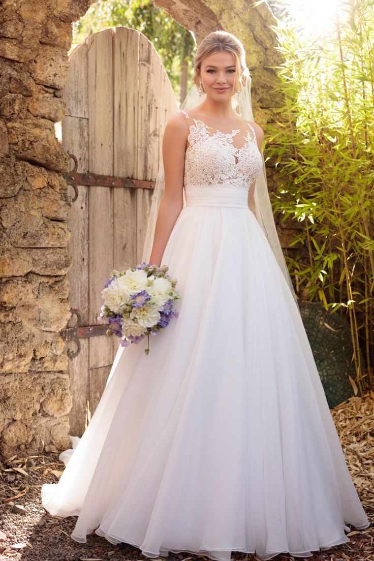 Wedding Dress out of Essense of Australia (D2183)Style D2183 Featuring a unique, asymmetrical illusion neckline, this wedding dress from Essense of Australia was designed to make a statement!