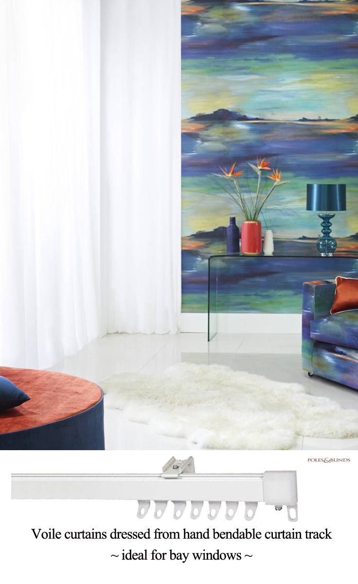 Highlights of orange stand out against the attractive blues and greens of the Prestigious wallpaper and fabric. The pure white voile curtains are fitted to a bendable curtain track. From £24. Online at http://www.polesandblinds.com/speedy-fineline-hand-bendable-metal-curtain-track-set/?colour=White #interiordesign #curtains #livingrooms