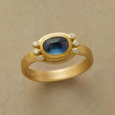 STARSHINE SAPPHIRE RING--The stars come out as twinkling diamonds flank our dusky blue, rose cut sapphire. Matte finished gold, the setting in 22kt, the hammered band in 18kt. Handcrafted in USA by Ananda Khalsa. This item will ship from our supplier in 3 weeks. Whole sizes 5 to 9.