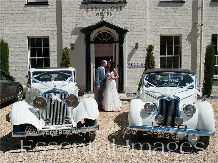 Two stunning wedding cars with bride and groom @Sharon Johnston Close Hotel on a glorious sunny day. Wedding photography by Malcolm @ http://www.essentialimagesweddings.co.uk