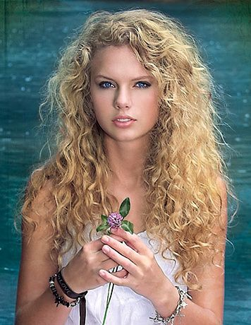i have always preffered her hair natrually curly, like this, than with a curling iron
