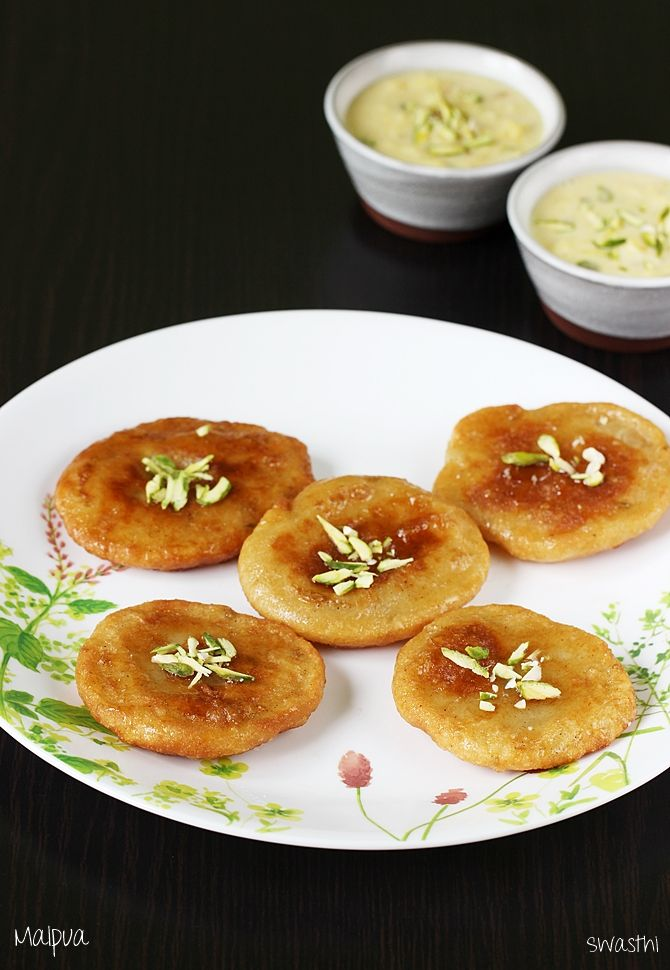 Easy malpua recipe – Detailed recipe of malpua along with step by step photos. Malpua is a sweet pancake popular in Uttar pradesh, Rajsthan, Bihar, West bengal, Orissa and Maharashtra. However each region has a different version of making these. Apart from flour different ingredients like fruit, milk, khoya and even coconut are used in …