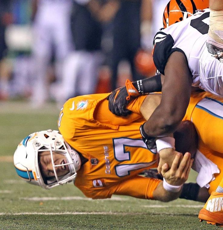 Miami Dolphins quarterback Ryan Tannehill is sacked in the fourth quarter as they are defeated by the Cincinnati Bengals at Paul Brown Stadium in Cincinnati, Ohio on Thurs., Sept. 29, 2016.