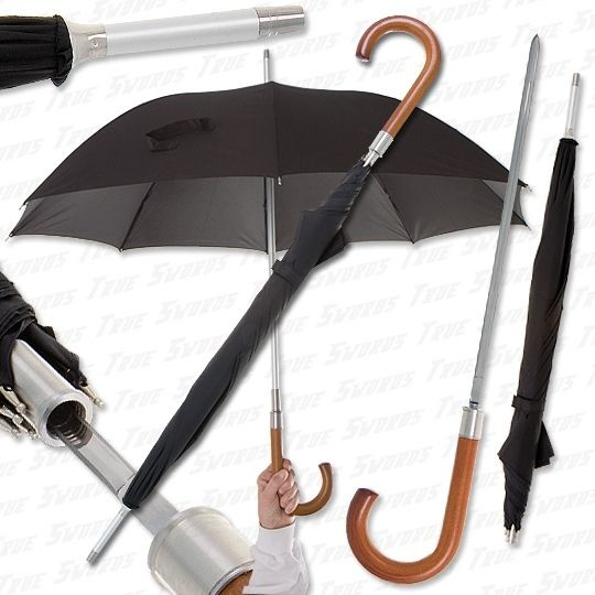 Sword Cane - Covert Umbrella Sword / Cane Blade / Hidden Weapon //   Ordinary looking umbrella and walking cane with covert sword blade. The natural finish hardwood hook handle opens to reveal a double edged sword blade. The silver umbrella tip doubles as a jabbing weapon. 35 in. overall closed, 15 in. blade.