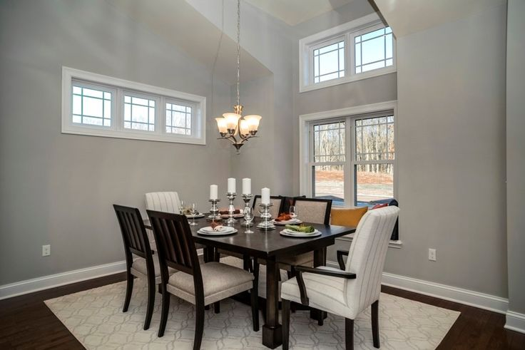 Distinctive architecture, cathedral ceiling, and cozy window seat make this a dining room to remember.