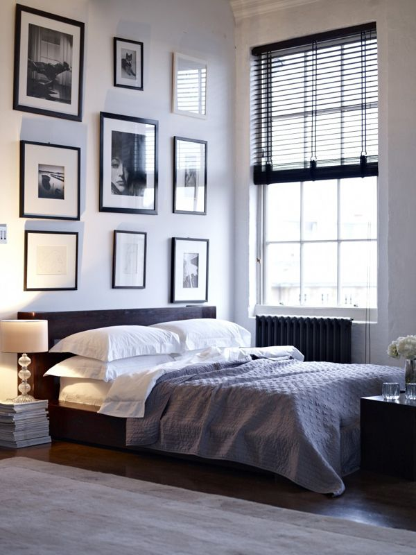 Love this grey, black and white master bedroom/ It has a hotel feel. I like the black frames on the wall too.