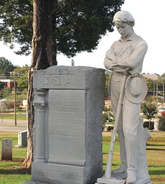 This statue of a Civil War soldier was ordered in 1912 to stand on the Limestone County Courthouse lawn. However, many residents thought its bowed head looked too defeated so it was moved to Athens City Cemetery, where it overlooks markers of the Civil War dead. A new statue was ordered for the courthouse where it remains today.