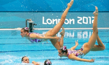 Are they on wires? Synchronised swimmers from Great Britain perform amazing gravity defying moves as they compete in the women's teams synchronised swimming technical routine at the Aquatics Centre. Photograph: Adam Pretty/Getty Images