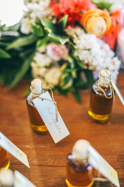 Olive oil favors doubling as place cards. Stationary to match escort cards.
