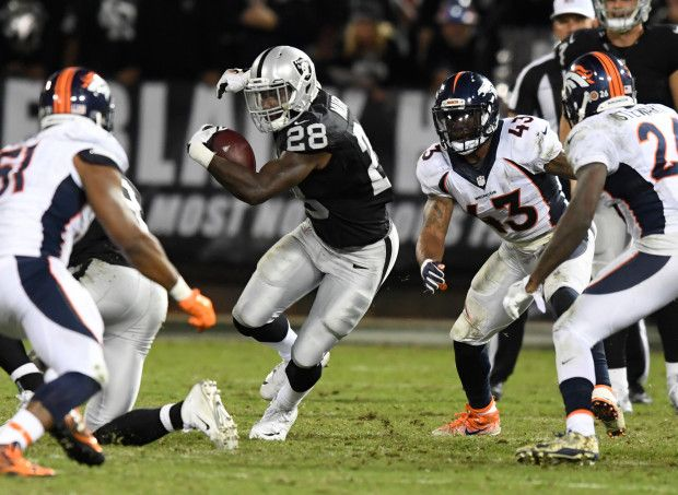 Broncos vs. Raiders:   November 6, 2016  -  30-20, Raiders  -    Oakland Raiders running back Latavius Murray (28) picks up a big gain against the Denver Broncos defense during the third quarter of an NFL game at Oakland-Alameda County Coliseum on Nov. 6, 2016 in Oakland, Calif. Murray ended the night with 114 yards rushing and 3 touchdowns.