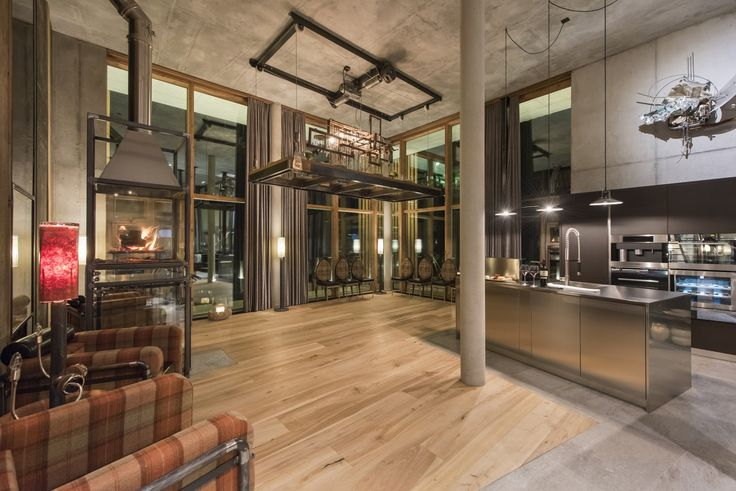 The dining table is suspended from the ceiling and can be winched up, leaving a great floor space for pre-dinner drinks and canapes or dancing.