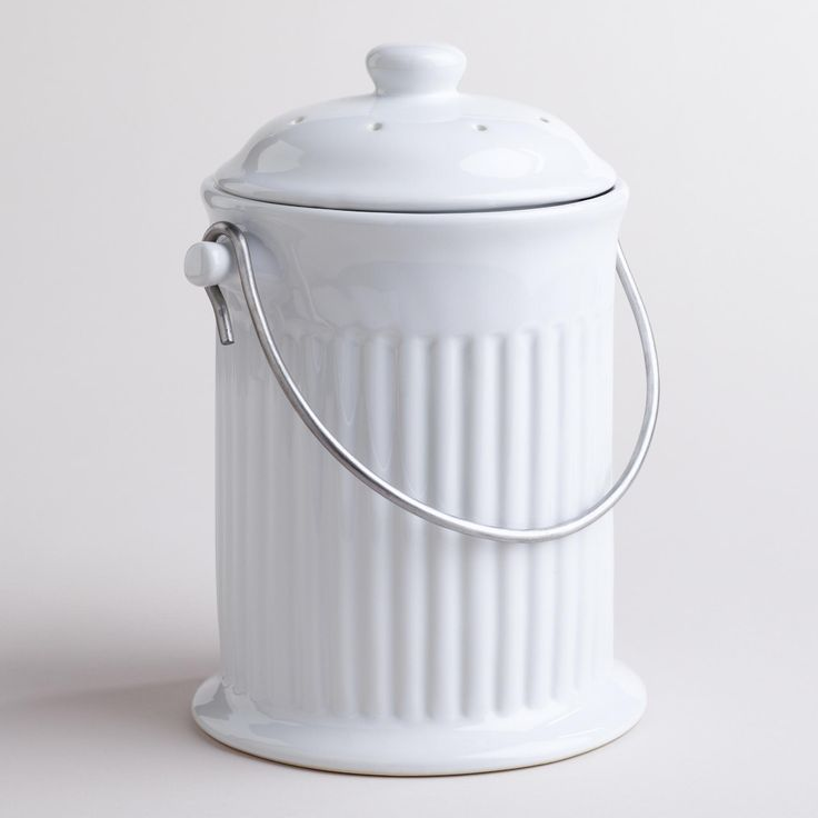 Our White Ceramic Compost Bucket is pretty and compact enough to sit right on the kitchen counter, accessible at all times. Small holes in the lid keep it perfectly ventilated. Use it with our charcoal filters and compost bags to keep odors and scraps properly contained. Compare it to ceramic compost buckets found elsewhere to appreciate our great price!