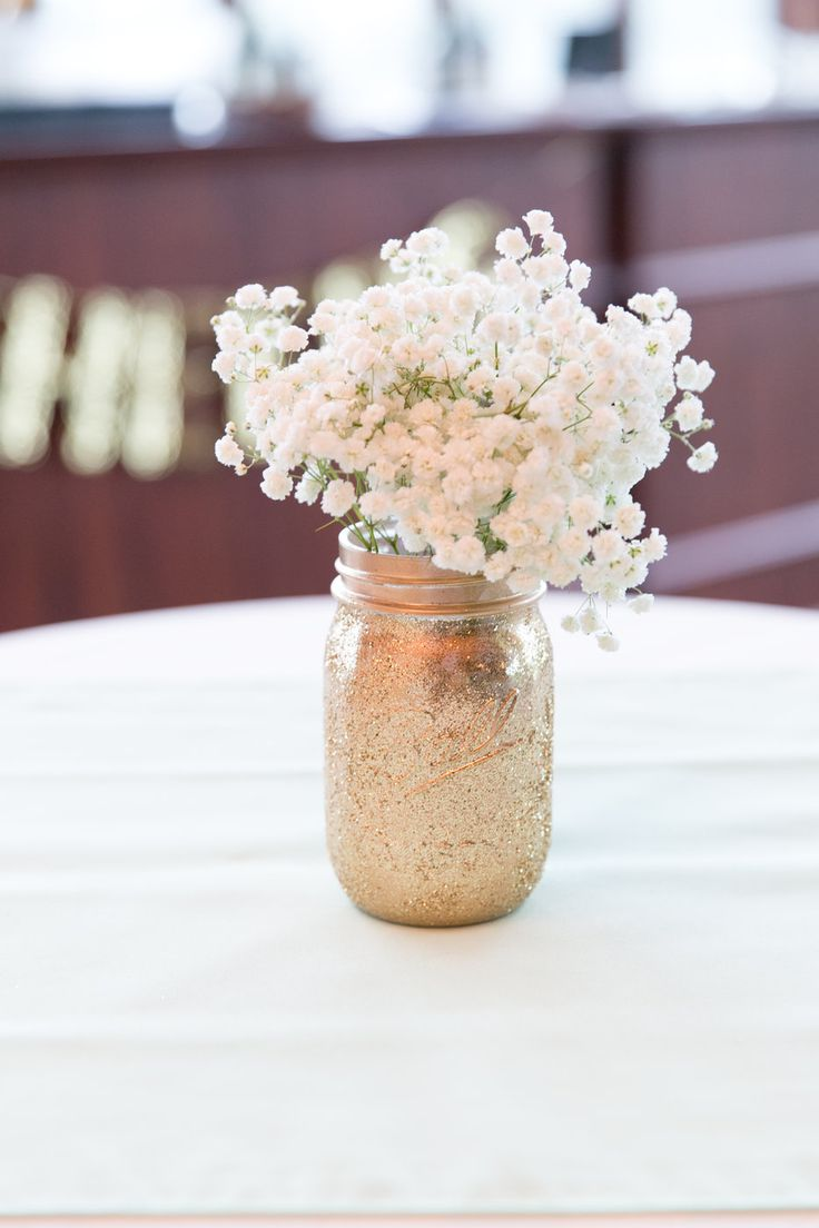 Patrick + Brenna Wedding Photo By Brittney Kreider Photography  Glitter gold mason jars and babies breath