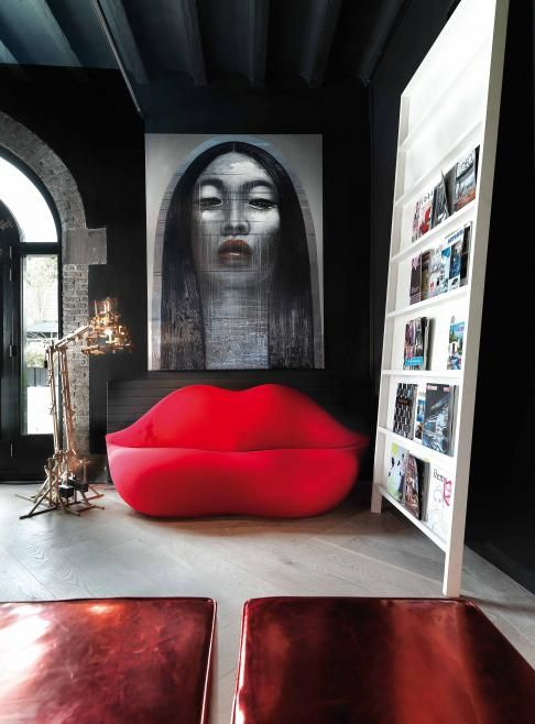 ♂ modern interior design with bold wall deco and red lip sofa